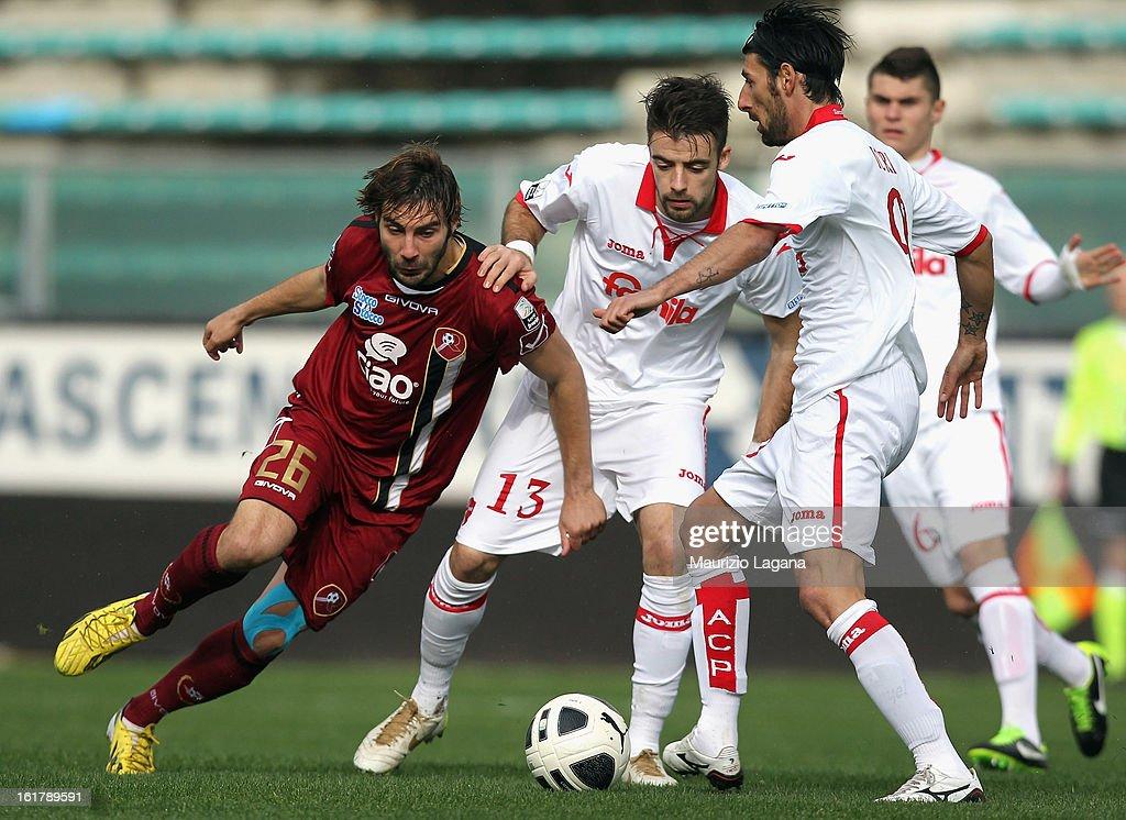 Gianmario Comi (L) of Reggina competes for the ball with Elia Legati (C) and Manuel Iori of Padova during the Serie B match between Reggina Calcio and Calcio Padova on February 16, 2013 in Reggio Calabria, Italy.
