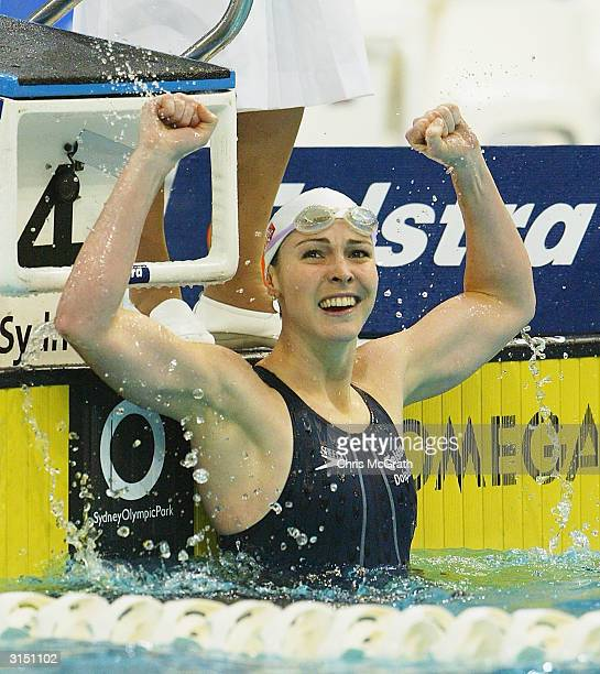 Giann Rooney celebrates victory in the Women's 100 metre Backstroke final during day three of the 2004 Telstra Olympic Team Swimming Trials held...