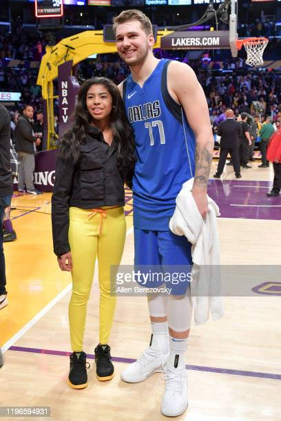 Gianna Bryant poses for a photo with Luka Doncic after a basketball game between the Los Angeles Lakers and the Dallas Mavericks at Staples Center on...