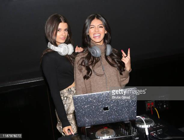 Gianna Ferazi and Jocelyn Delgado pose during a launch event promoting Selfie Kid X Brooklyn Cloth Limited Edition TShirt Collaboration at Planet...