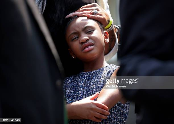 Gianna Floyd, daughter of George Floyd, stands with other members of the Floyd family as they answer questions outside the White House following a...