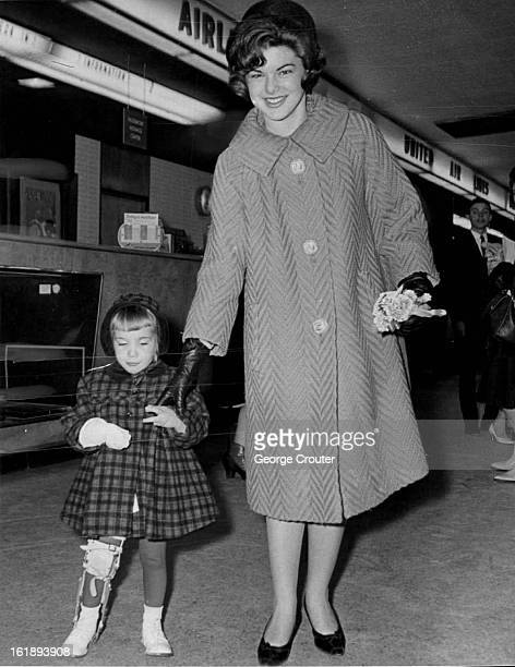 MAR 5 1963 MAR 6 1963 Gianna Greets Miss Teen Gianna Costo Denver's Easter Seal Child was on hand to welcome Miss Teen USA teenage chairman of the...