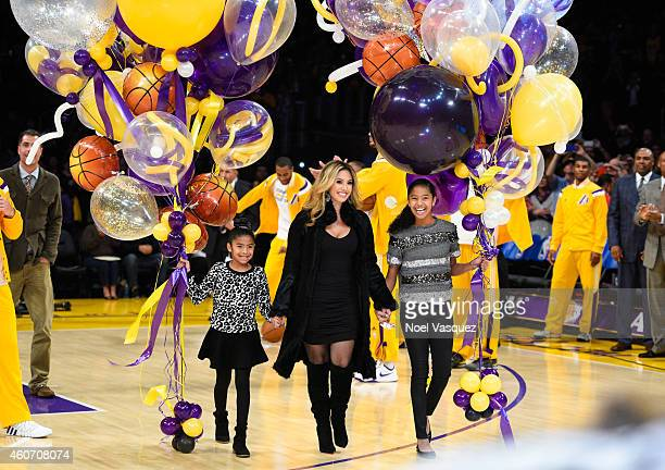 Gianna Maria-Onore, Vanessa Bryant and Natalia Diamante Bryant bring out balloons to Kobe Bryant at a basketball game between the Oklahoma City...