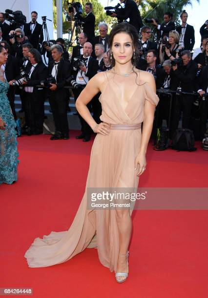 Gianna Simone attends the 'Ismael's Ghosts ' screening and Opening Gala during the 70th annual Cannes Film Festival at Palais des Festivals on May 17...