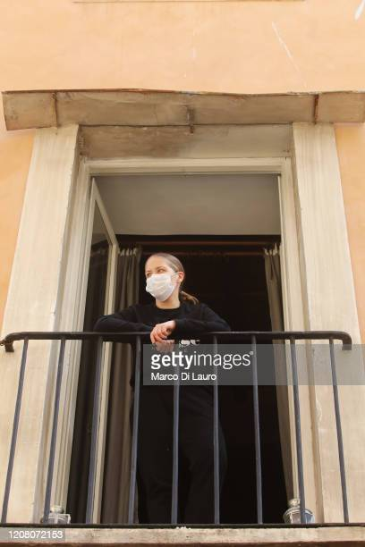 Gianna Succi an independent American journalist looks out of her window on March 22 2020 in Rome Italy Gianna has had a fever in the last few days...