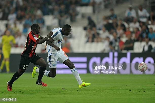 Giannelli Imbula of Marseille and Nampalys Mendy of Nice compete for the ball during the French Ligue 1 match between Olympique de Marseille and OGC...