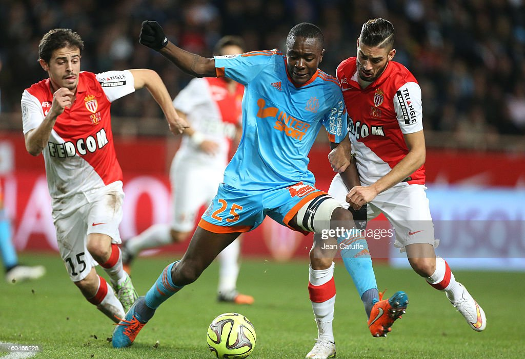 Giannelli Imbula of OM in action between Bernardo Silva and Yannick Ferreira Carrasco of Monaco during the French Ligue 1 match between AS Monaco FC v Olympique de Marseille OM at Stade Louis II on December 14, 2014 in Monaco.