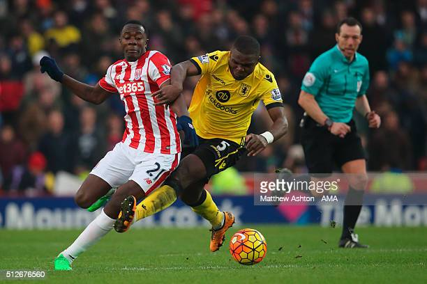 Giannelli Imbula of Stoke City and Jores Okore of Aston Villa during the Barclays Premier League match between Stoke City and Aston Villa at the...