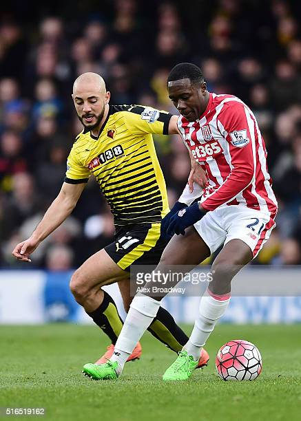 Giannelli Imbula of Stoke City and Nordin Amrabat of Watford compete for the ball during the Barclays Premier League match between Watford and Stoke...