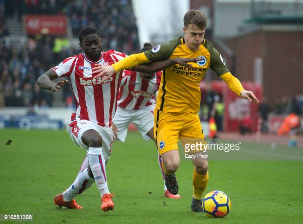 Giannelli Imbula of Stoke City and Solly March of Brighton and Hove Albion battle for the ball during the Premier League match between Stoke City and...