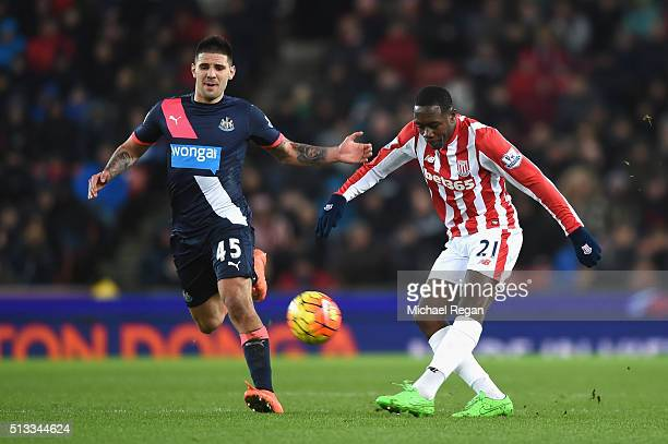 Giannelli Imbula of Stoke City beats Aleksandar Mitrovic of Newcastle United to the ball during the Barclays Premier League match between Stoke City...