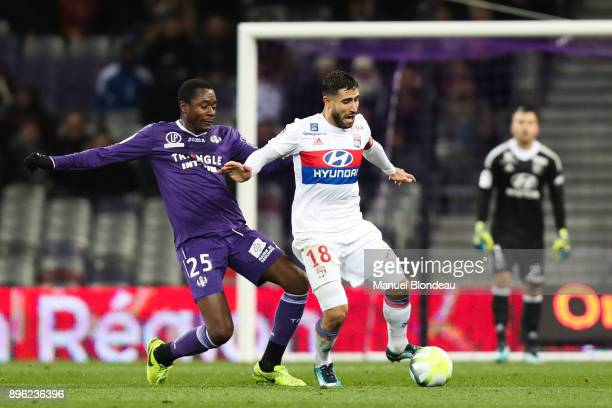 Giannelli Imbula of Toulouse and Nabil Fekir of Lyon during the Ligue 1 match between Toulouse and Olympique Lyonnais at Stadium Municipal on...