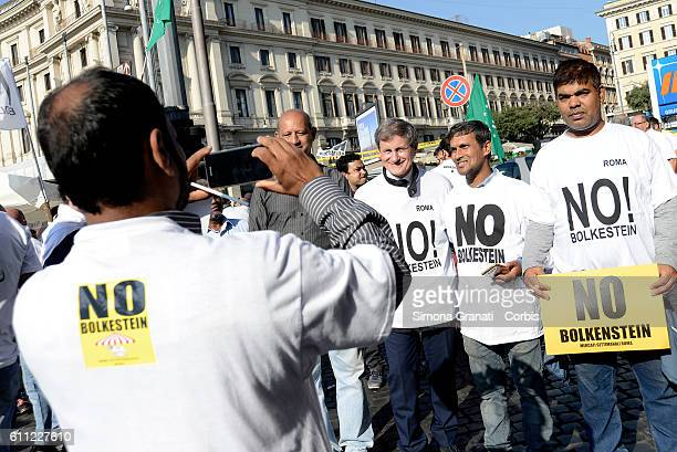 Gianni Alemanno gets a sellfie with migrants during the national demonstration of street vendors against the Bolkestein Directive on September 28...