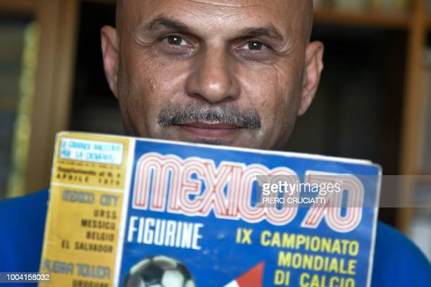 Gianni Bellini, owner of the largest Panini football stickers collection in the world, poses for a picture with the 1970 Mexico World Cup Panini...