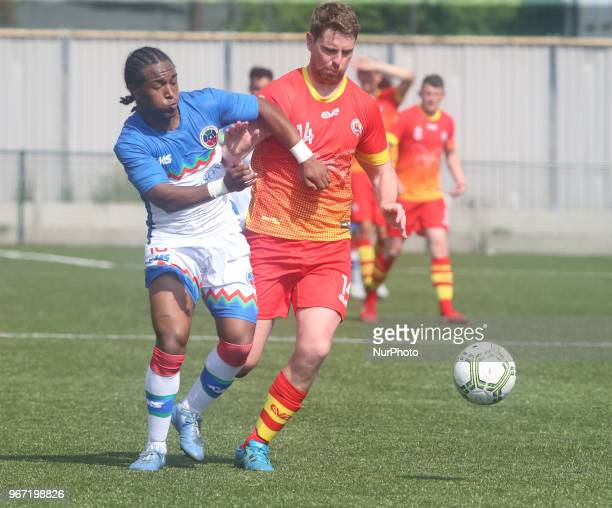 LR Gianni Chrichlow of Barrawa and Jack William McVey of Ellan Vannin during Conifa Paddy Power World Football Cup 2018 Group A match between Barawa...