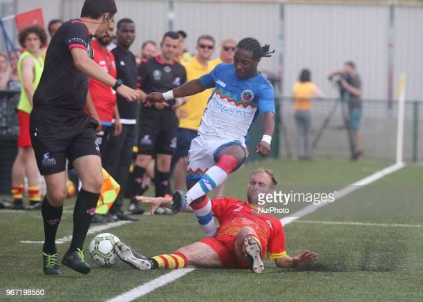 LR Gianni Chrichlow of Barrawa and Sam Edwin Caine of Ellan Vannin during Conifa Paddy Power World Football Cup 2018 Group A match between Barawa...