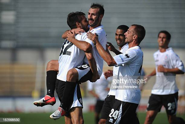 Gianni Fabiano of FC Pro Vercelli celebrates with his teammates after scoring their third goal from the penalty spot during the Serie B match between...