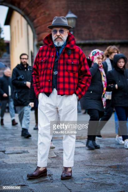 Gianni Fontana wearing a red tweed jacket is seen during the 93 Pitti Immagine Uomo at Fortezza Da Basso on January 11 2018 in Florence Italy