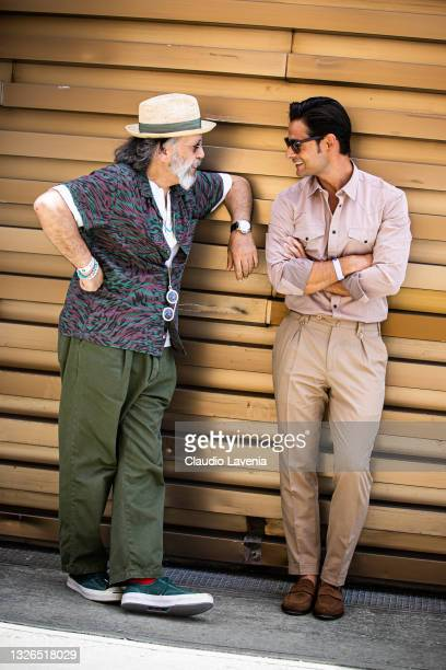 Gianni Fontana, wearing green pants, white t-shirt and multicolor shirt and Frank Gallucci, wearing beige pants and shirt, are seen at Fortezza Da...