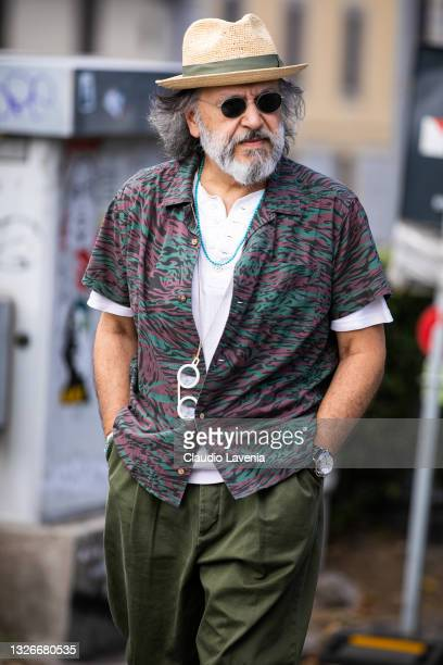 Gianni Fontana, wearing green pants, white t-shirt and multicolor shirt, is seen at Fortezza Da Basso on July 01, 2021 in Florence, Italy.