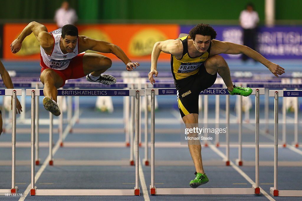 Gianni Frankis (R) on his way to victory from Allan Scott (L) in the men's 60m hurdles final during day one of the British Athletics European Trials & UK Championship at the English Institute of Sport on February 9, 2013 in Sheffield, England.