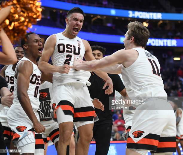 Gianni Hunt Jarod Lucas and Zach Reichle of the Oregon State Beavers celebrate after Lucas hit a gamewinning 3pointer against the Utah Utes during...