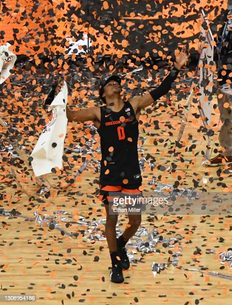 Gianni Hunt of the Oregon State Beavers celebrates the team's 70-68 victory over the Colorado Buffaloes to win the championship game of the Pac-12...