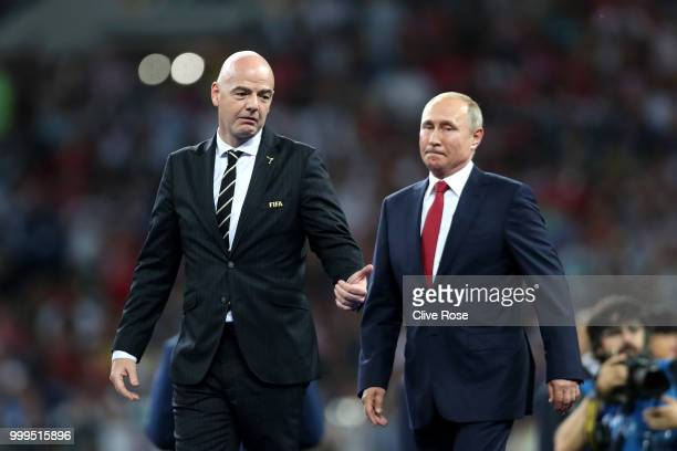 Gianni Infantino FIFA President and Vladimir Putin President of the Russian Federation walk to the podium following the 2018 FIFA World Cup Final...