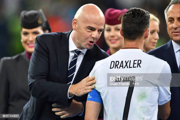 Gianni Infantino FIFA president speaks to Julian Draxler of Germany after the FIFA Confederations Cup Russia 2017 Final between Chile and Germany at...