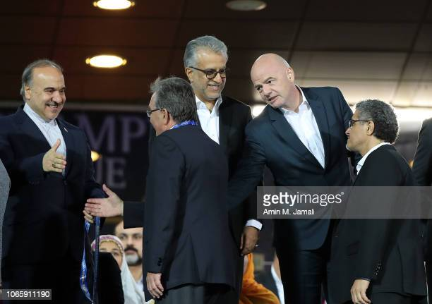 Gianni Infantino President of Fédération Internationale de Football Association and AFC chief Sheikh Salman and Branko Ivancovic looks on after the...