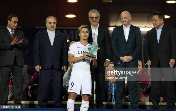 Gianni Infantino President of Fédération Internationale de Football Association and AFC chief Sheikh Salman and Yuma Suzuki look on after the AFC...