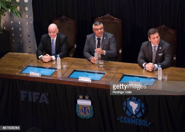 Gianni Infantino president of FIFA Claudio Chiqui Tapia president of AFA and Alejandro Dominguez of CONMEBOL during a press conference at AFA as part...