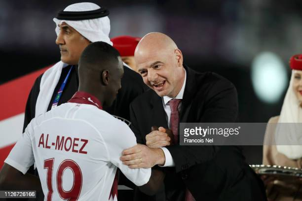 Gianni Infantino president of FIFA congratulates Almoez Ali of Qatar following the AFC Asian Cup final match between Japan and Qatar at Zayed Sports...