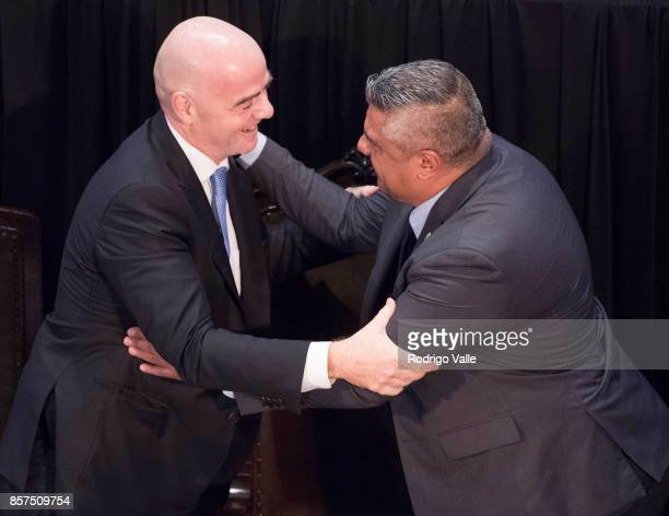 Gianni Infantino president of FIFA greets Claudio Chiqui Tapia president of AFA during a press conference at AFA as part of the official visit of...