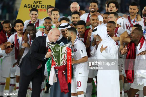 Gianni Infantino president of FIFA hands over the AFC Asian Cup trophy to Hasan Al Haydos of Qatar following their sides victory in the AFC Asian Cup...