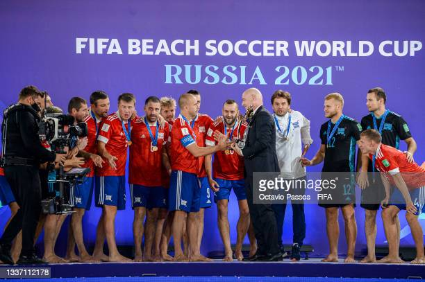 Gianni Infantino, President of FIFA presents Anton Shkarin of Football Union of Russia with The FIFA Beach Soccer World Cup Winner's Trophy following...