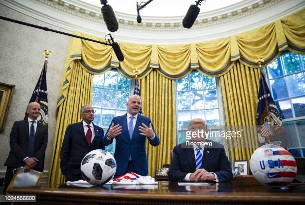 Gianni Infantino president of FIFA second right speaks as US President Donald Trump right and Carlos Cordeiro president of the United States Soccer...