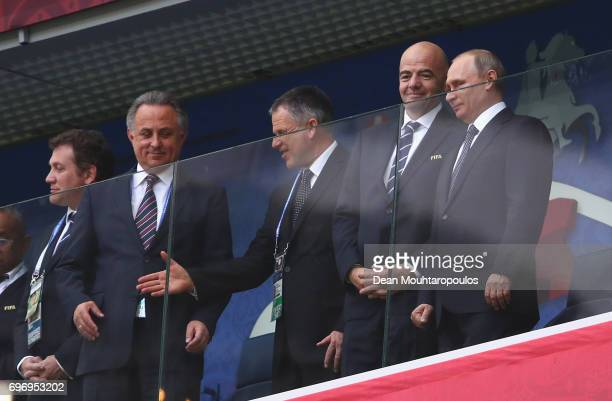 Gianni Infantino President of FIFA speaks to Vladimir Putin President of Russia prior to the FIFA Confederations Cup Russia 2017 Group A match...