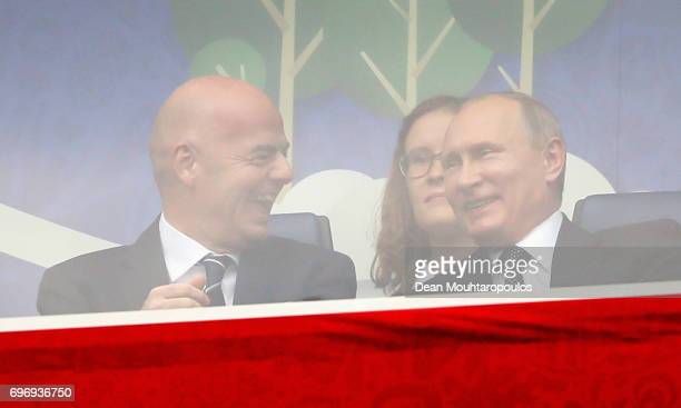 Gianni Infantino President of FIFA talks with Russian President Vladimir Putin while watching the game during the FIFA Confederations Cup Russia 2017...