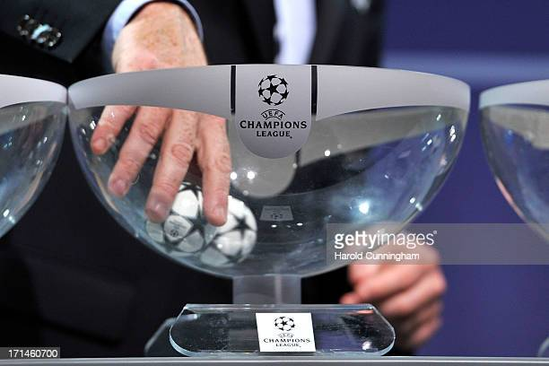 Gianni Infantino, UEFA General Secretary, draws a ball during the UEFA Champions League Q2 qualifying round draw at the UEFA headquarters on June 24,...