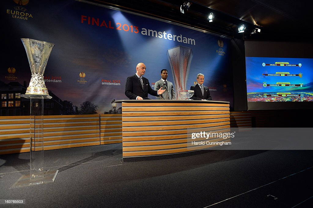 Gianni Infantino, UEFA General Secretary, Patrick Kluivert, UEFA Europa League Final Ambassador, and Giorgio Marchetti, UEFA Competition Director, comment on the results after the UEFA Europa League quarter finals draw at the UEFA headquarters on March 15, 2013 in Nyon, Switzerland.
