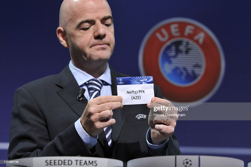 Gianni Infantino, UEFA General Secretary, shows the name Neftchi PFK during the UEFA Champions League Q2 qualifying round draw at the UEFA headquarters on June 24, 2013 in Nyon, Switzerland.
