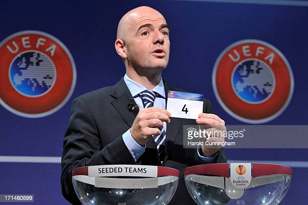 Gianni Infantino, UEFA General Secretary, shows the number 4 during the UEFA Europa League Q1 qualifying round draw at the UEFA headquarters on June...