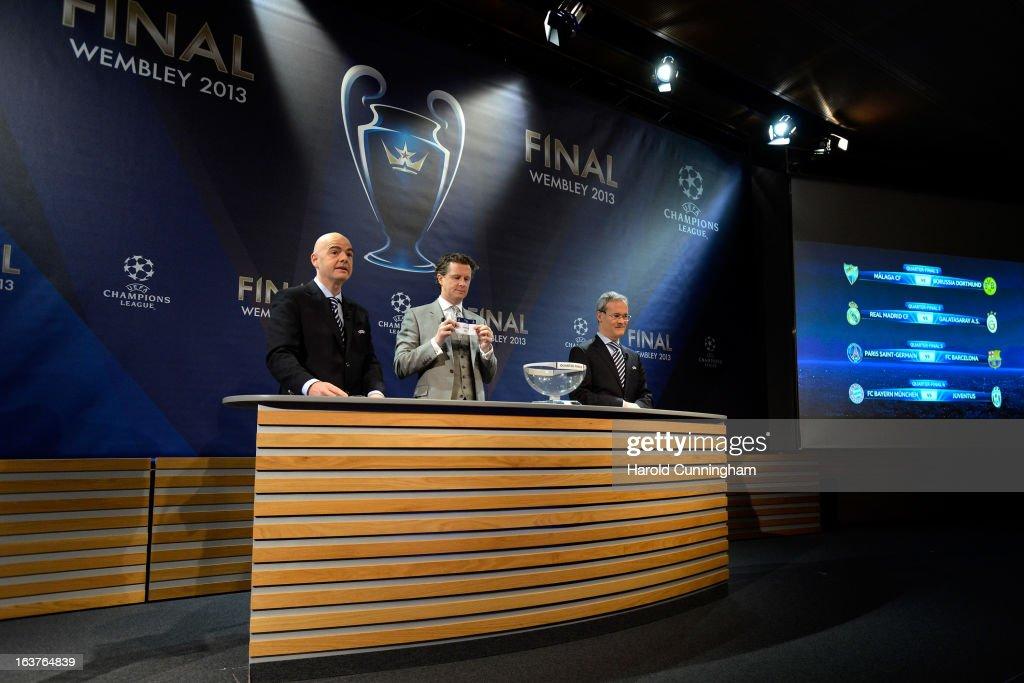Gianni Infantino, UEFA General Secretary, Steve McManaman, UEFA Champions League Final Ambassador, and Giorgio Marchetti, UEFA Competition Director, draw the last ball during UEFA Champions League quarter finals draw at the UEFA headquarters on March 15, 2013 in Nyon, Switzerland.