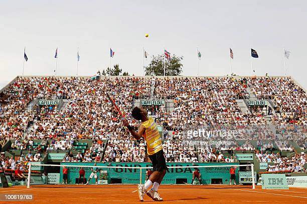 Gianni Mina of France serves during the men's singles first round match between Rafael Nadal of Spain and Gianni Mina of France on day three of the...