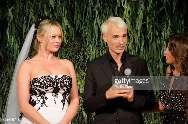 Gianni Molaro neapolitan fashion designer at fashion exhibiton Ti Sposo with Anna Falchi wears his creation