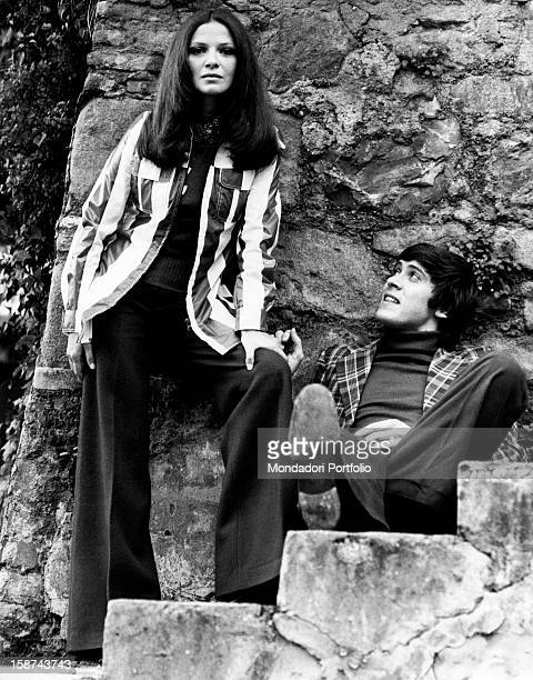Gianni Morand with his wife, The Italian actress known as Laura Efrikian, on a stone staircase. Italy, 1972.