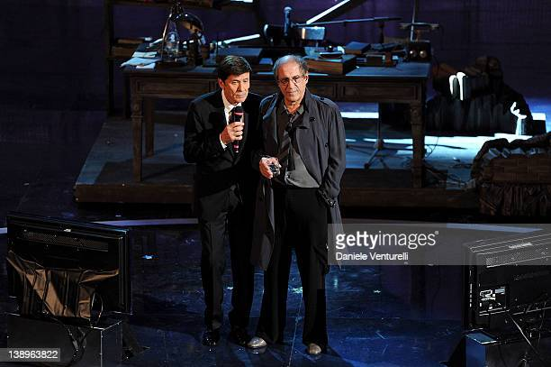Gianni Morandi and Adriano Celentano attend the opening night of the 62th Sanremo Song Festival at the Ariston Theatre on February 14, 2012 in San...
