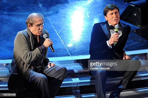 Gianni Morandi and Adriano Celentano performs on stage at the closing night of the 62th Sanremo Song Festival at the Ariston Theatre on February 18...