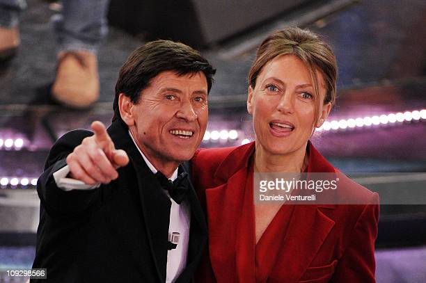Gianni Morandi and Anna Dan attend the closing night of the 61st Italian Song Festival at the Ariston Theatre on February 19 2011 in San Remo Italy